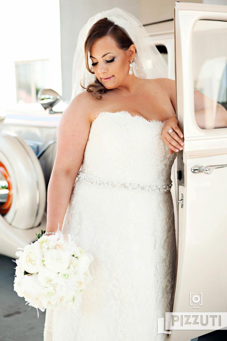 bride-wedding-gown-flowers-car