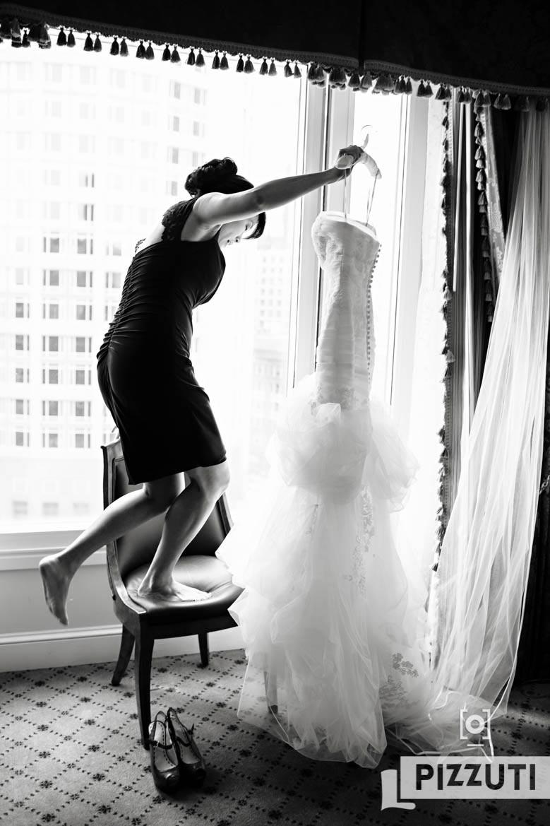 Bridesmaid Prepares Dress