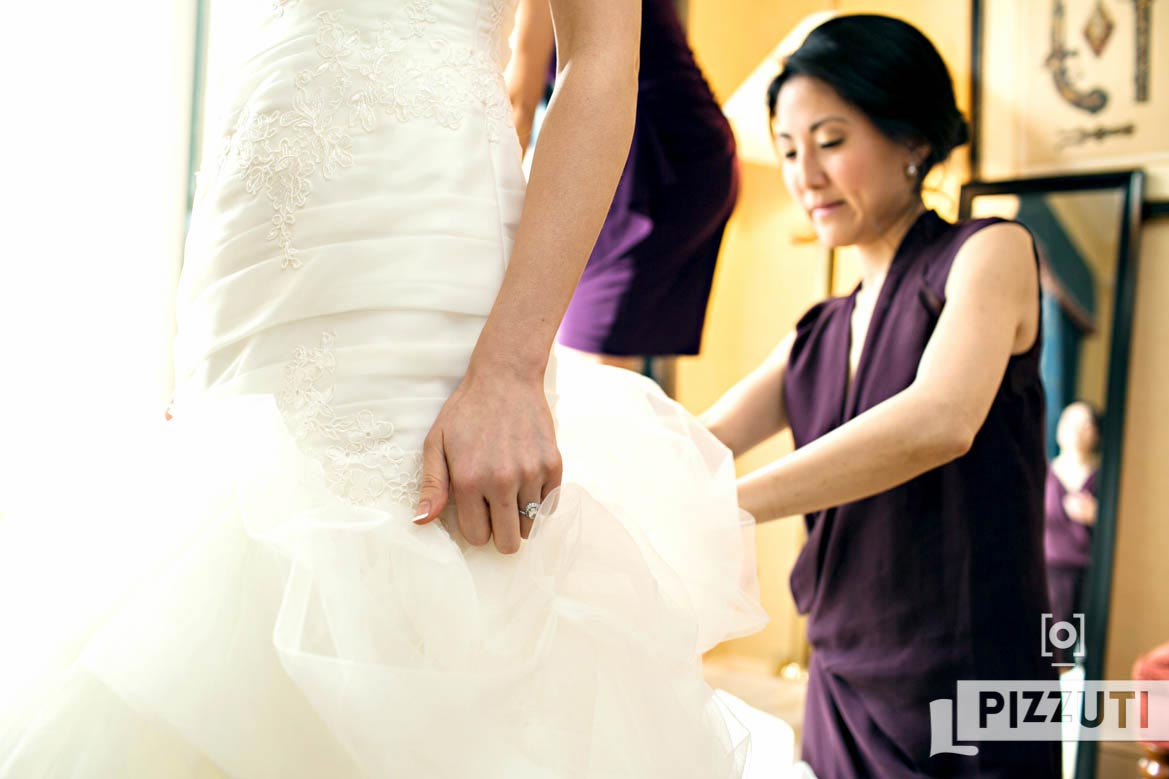 Brides Maid Helping With Dress