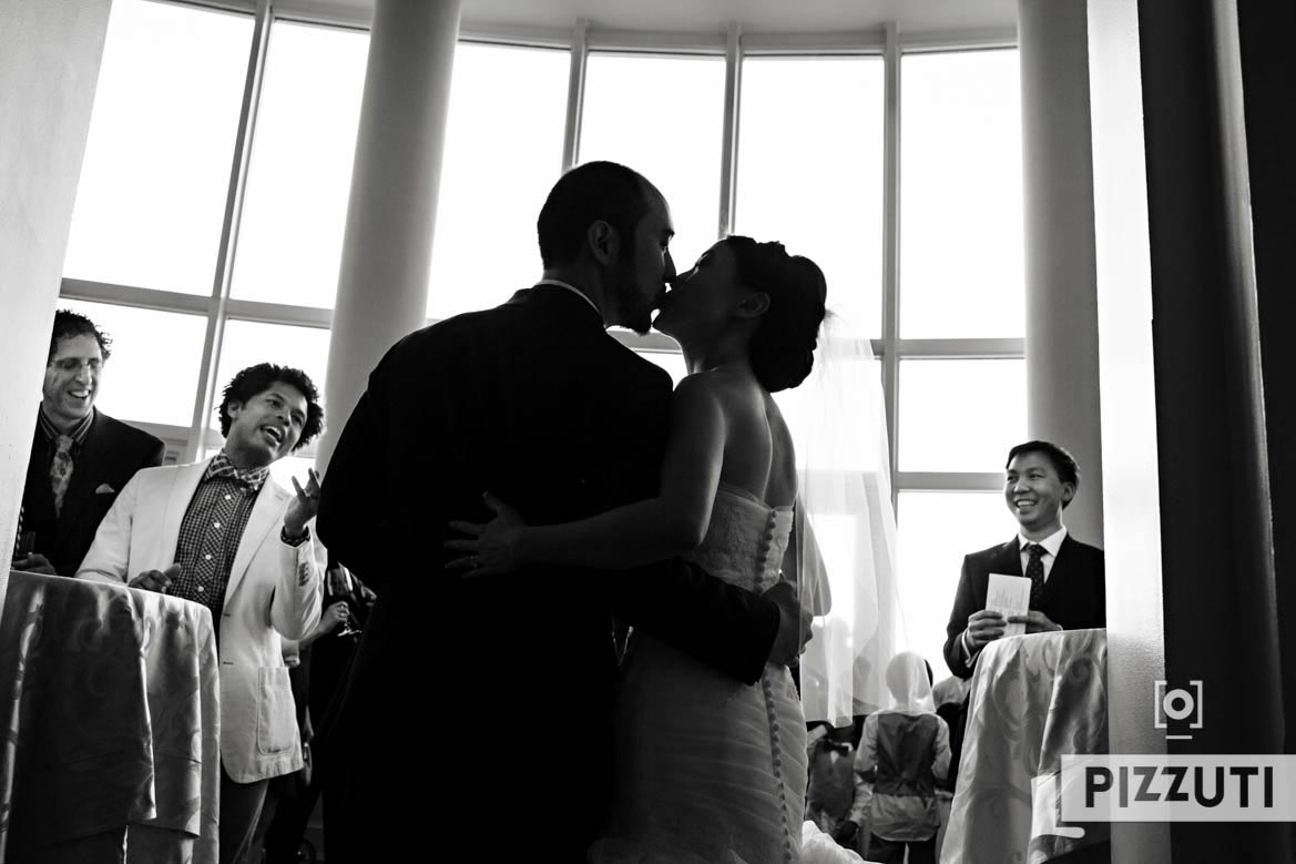 Bride And Groom Sneak A Kiss At Cocktail Hour