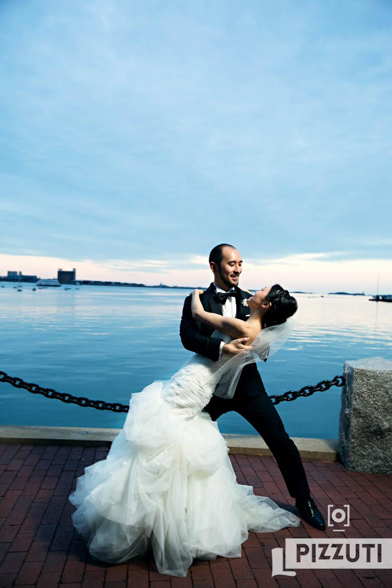 Bride And Groom Outside Boston Harbor Hotel