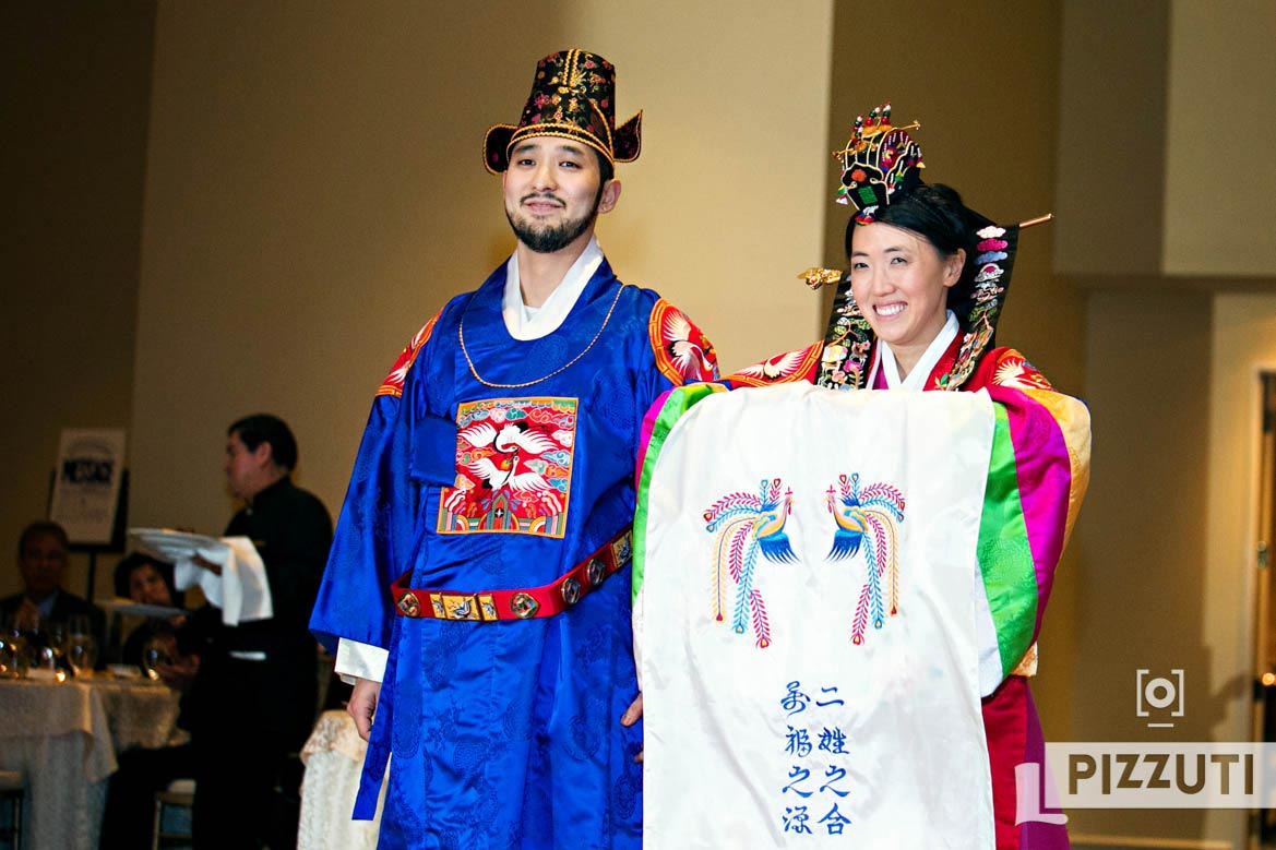 Bride And Groom Enter Traditional Korean Wedding Ceremony