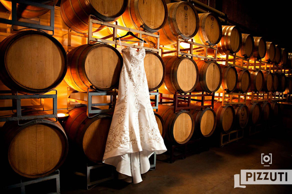 wedding dress hanging in winery venue
