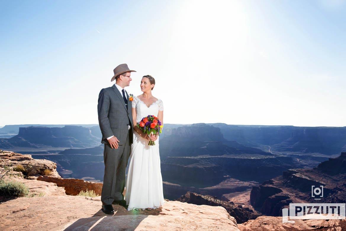 bride and groom pose during their Moab Utah wedding